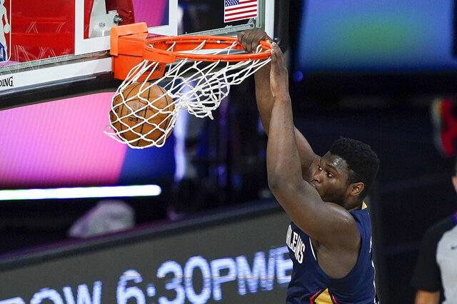 New Orleans Pelicans forward Zion Williamson dunks the ball during the first half of an NBA basketball game against the San Antonio Spurs, Sunday, Aug. 9, 2020, in Lake Buena Vista, Fla. (AP Photo/Ashley Landis, Pool)