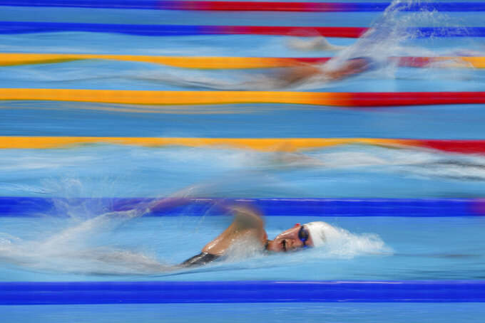Han Da-kyung, of South Korea, swims in a heat during the women's 1500-meter freestyle at the 2020 Summer Olympics, Monday, July 26, 2021, in Tokyo, Japan. (AP Photo/Matthias Schrader)