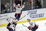 Washington Capitals' Alex Ovechkin (8) and Dmitry Orlov (9) celebrate a goal by Tom Wilson (43) during the third period of an NHL hockey game against the New York Islanders Saturday, Jan. 18, 2020, in Uniondale, N.Y. The Capitals won 6-4. (AP Photo/Frank Franklin II)