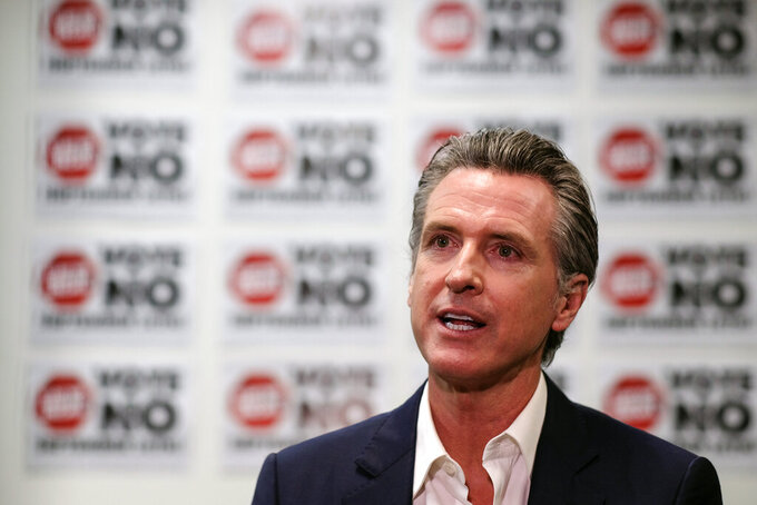California Gov. Gavin Newsom is photographed during a TV interview before a rally against the California gubernatorial recall election on Sunday, Sept. 12, 2021, in Sun Valley, Calif. (AP Photo/Ringo H.W. Chiu)