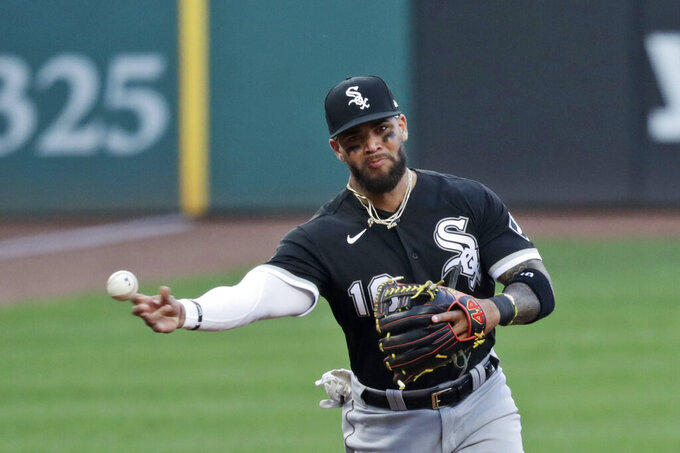 Chicago White Sox's Yoan Moncada throws out Cleveland Indians' Domingo Santana at first base in the first inning in the second baseball game of a doubleheader, Tuesday, July 28, 2020, in Cleveland. (AP Photo/Tony Dejak)