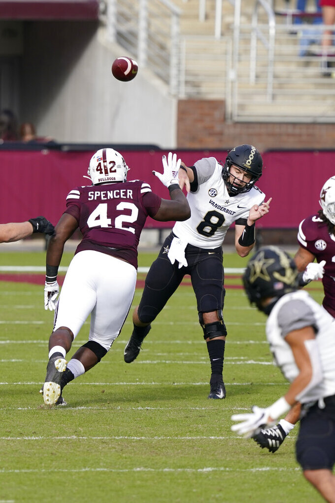 Vanderbilt quarterback Ken Seals (8) is pressured by Mississippi State defensive end Marquiss Spencer (42) as he passes during the first half of an NCAA college football game in Starkville, Miss., Saturday, Nov. 7, 2020. (AP Photo/Rogelio V. Solis)