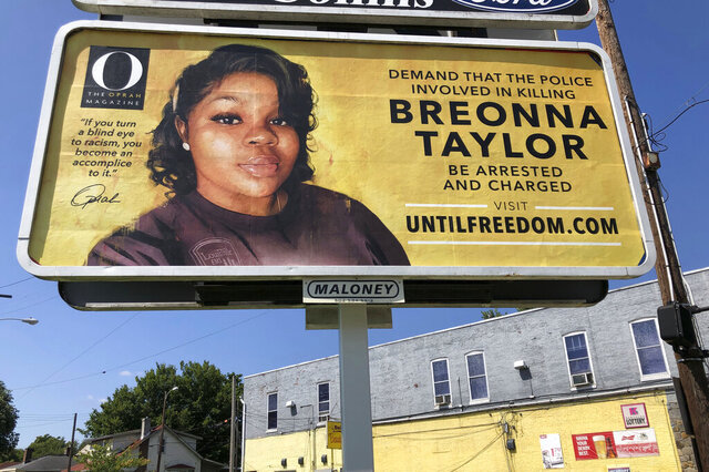 A billboard sponsored by O, The Oprah Magazine, is on display with with a photo of Breonna Taylor, Friday, Aug. 7, 2020 in Louisville, KY. Twenty-six billboards are going up across Louisville, demanding that the police officers involved in Taylor's death be arrested and charged.  Taylor was shot multiple times March 13 when police officers burst into her Louisville apartment using a no-knock warrant during a narcotics investigation. No drugs were found. (AP Photo/Dylan T. Lovan)