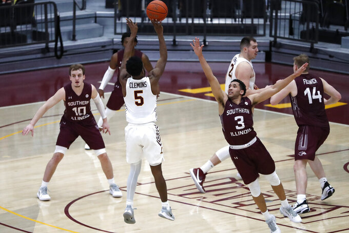 Loyola Chicago guard Keith Clemons (5) shoots a three-point basket while Southern Illinois' Dalton Banks tries to block during the first half of an NCAA college basketball game Friday, Feb. 26, 2021, in Chicago. (AP Photo/Shafkat Anowar)