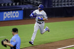 Los Angeles Dodgers left fielder A.J. Pollock reacts after hitting a home run during the ninth inning of the team's baseball game against the San Diego Padres, Tuesday, Aug. 4, 2020, in San Diego. (AP Photo/Gregory Bull)