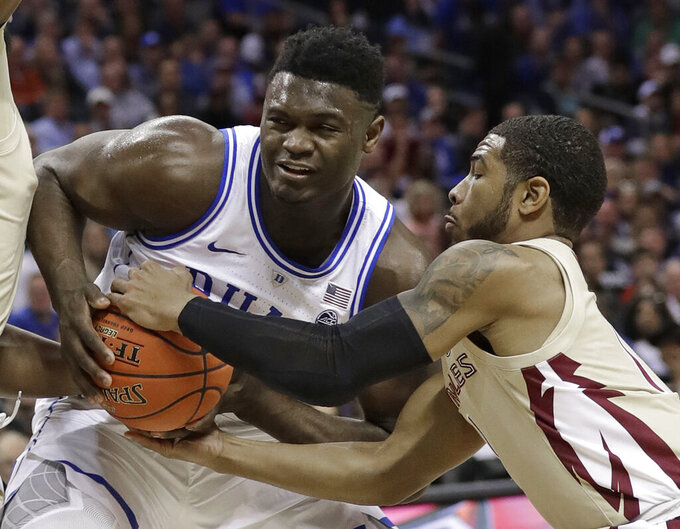 Florida State's David Nichols, right, steals the ball from Zion Williamson, left, during the first half of the NCAA college basketball championship game of the Atlantic Coast Conference tournament in Charlotte, N.C., Saturday, March 16, 2019. (AP Photo/Chuck Burton)