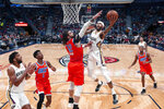 New Orleans Pelicans forward Brandon Ingram (14) goes to the basket against Oklahoma City Thunder center Steven Adams (12) in the first half of an NBA basketball game in New Orleans, Sunday, Dec. 1, 2019. (AP Photo/Gerald Herbert)