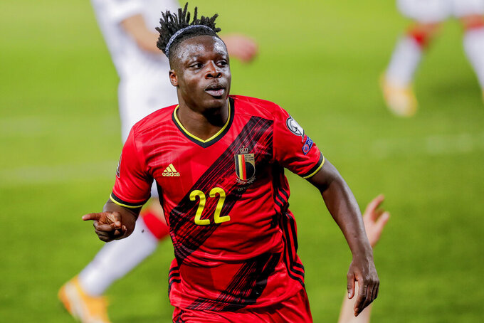 FILE - In this March 30, 2021 file photo, Belgium's Jeremy Doku celebrates after scoring his side's fourth goal during a World Cup 2022 group E qualifying soccer match between Belgium and Belarus at the King Power stadium in Leuven, Belgium. Jeremy Doku and Leandro Trossard were called up Monday, May 17, 2021 for the Belgium squad alongside the usual stalwarts for the European Championship. Belgium will play in Group B, opening against Russia on June 12. The top-ranked Belgians will then face Denmark and Finland. (AP Photo/Francisco Seco, File)