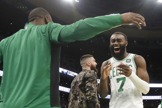 Boston Celtics guard Jaylen Brown (7) celebrates with teammate Kemba Walker in the second half of an NBA basketball game against the Detroit Pistons, Friday, Dec. 20, 2019, in Boston. (AP Photo/Elise Amendola)