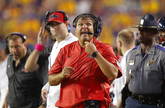 Mississippi coach Matt Luke calls out from the sideline during the first half of the team's NCAA college football game against LSU in Baton Rouge, La., Saturday, Sept. 29, 2018. LSU won 45-16. (AP Photo/Gerald Herbert)