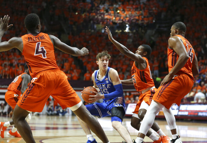 Duke's Alex O'Connell (15) is surrounded by Virginia Tech defenders during the first half of an NCAA college basketball game Friday, Dec. 6, 2019, in Blacksburg, Va. (Matt Gentry/The Roanoke Times via AP)