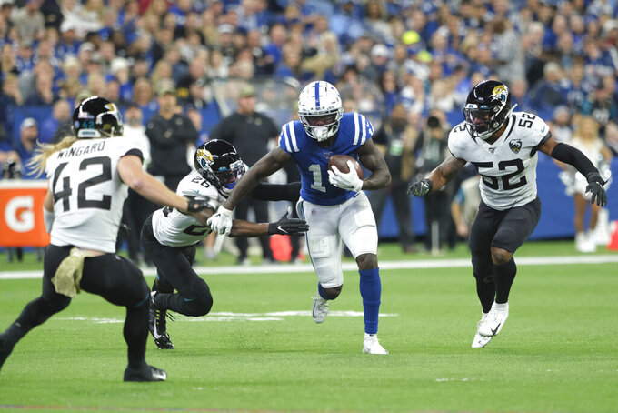 Indianapolis Colts wide receiver Zach Pascal (14) is tackled by Jacksonville Jaguars' Jarrod Wilson (26) during the first half of an NFL football game, Sunday, Nov. 17, 2019, in Indianapolis. (AP Photo/AJ Mast)