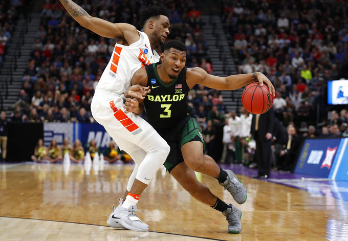Syracuse forward Oshae Brissett, left, guards Baylor guard King McClure (3) during the first half of a first-round game in the NCAA men's college basketball tournament Thursday, March 21, 2019, in Salt Lake City. (AP Photo/Jeff Swinger)