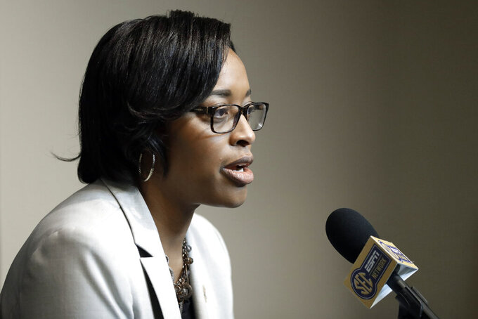 Vanderbilt interim athletic director Candice Lee answers questions during a news conference Wednesday, Feb. 5, 2020, in Nashville, Tenn. Former athletic director Malcolm Turner resigned Tuesday after one year at the school. (AP Photo/Mark Humphrey)