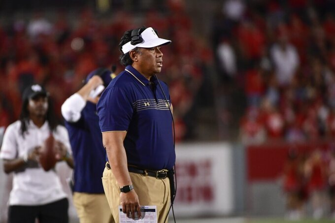 Navy head coach Ken Niumatalolo stands on the sideline during the second half of an NCAA college football game against Houston, Saturday, Sept. 25, 2021, in Houston. (AP Photo/Justin Rex)