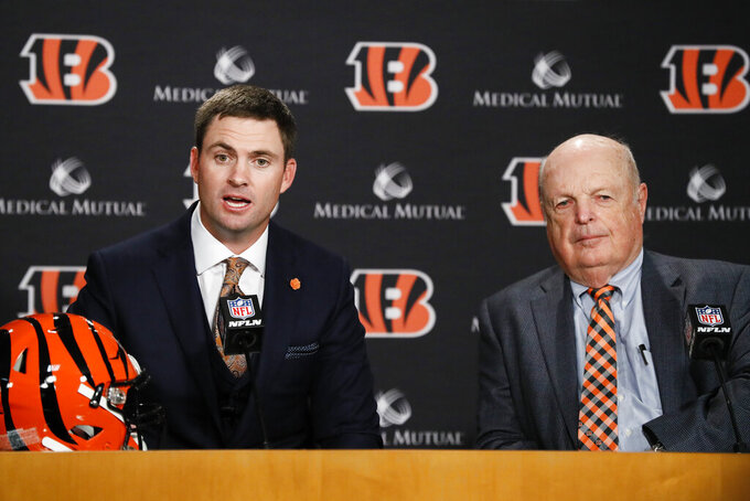 Cincinnati Bengals football head coach Zac Taylor, left, speaks alongside Bengals owner Mike Brown, right, during a news conference, Tuesday, Feb. 5, 2019, in Cincinnati. After 16 years without a playoff win under Marvin Lewis, the Bengals decided to try something different. But they had to wait more than a month before hiring Zac Taylor as their next coach in hopes of ending a long streak of futility. (AP Photo/John Minchillo)