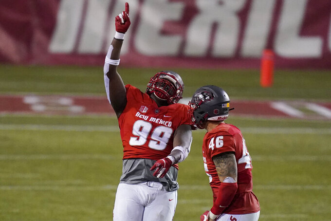 New Mexico nose tackle Ben Gansallo (99) celebrates after making a sack against Wyoming during the second half of an NCAA college football game Saturday, Dec. 5, 2020, in Las Vegas. (AP Photo/John Locher)
