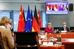 German Chancellor Angela Merkel attends virtual talks with Chinese Premier Li Keqiang as part of the Sixth German-Chinese Government Consultations, in Berlin, Germany April 28, 2021. (Michele Tantussi/Pool via AP)