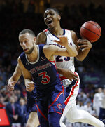 St. Mary's Jordan Ford (3) and Gonzaga's Zach Norvell Jr. collide during the first half of an NCAA college basketball game for the West Coast Conference men's tournament title, Tuesday, March 12, 2019, in Las Vegas. (AP Photo/John Locher)