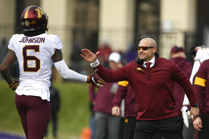 FILE - In this Saturday, Nov. 23, 2019, file photo, Minnesota head coach P.J. Fleck, right, celebrates with wide receiver Tyler Johnson (6) after Johnson caught a touchdown pass during the second half of an NCAA football game against Northwestern, in Evanston, Ill. Fleck has never lacked for clever ways to connect and motivate his players. (AP Photo/Paul Beaty, File)