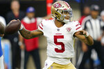 San Francisco 49ers quarterback Trey Lance (5) throws during the first half of a preseason NFL football game against the San Francisco 49ers Sunday, Aug. 22, 2021, in Inglewood, Calif. (AP Photo/Ashley Landis)