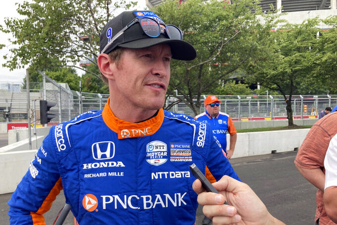 Six- time IndyCar champion Scott Dixon chats with the media before the start of practice of the IndyCar auto race, Friday, Aug. 6, 2021, in Nashville, Tenn. (AP Photo/Dan Gelston)
