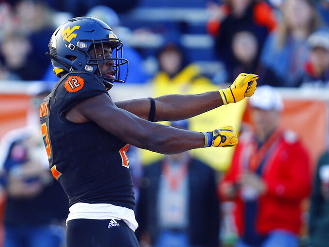 South wide receiver Gary Jennings, of West Virginia, celebrates after a touchdown during the second half of the Senior Bowl college football game, Saturday, Jan. 26, 2019, in Mobile, Ala. (AP Photo/Butch Dill)