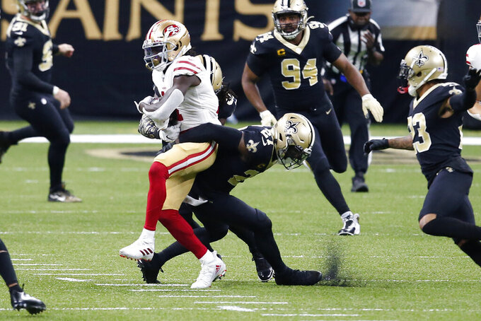 San Francisco 49ers wide receiver Brandon Aiyuk pulls in a reception against New Orleans Saints strong safety Malcolm Jenkins (27) in the first half of an NFL football game in New Orleans, Sunday, Nov. 15, 2020. (AP Photo/Butch Dill)