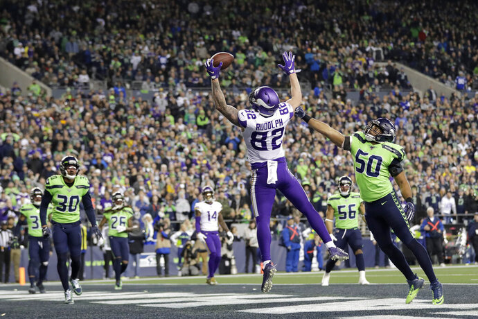 Minnesota Vikings' Kyle Rudolph reaches to catch a pass for a touchdown as Seattle Seahawks' K.J. Wright (50) reaches toward him during the second half of an NFL football game, Monday, Dec. 2, 2019, in Seattle. (AP Photo/Ted S. Warren)