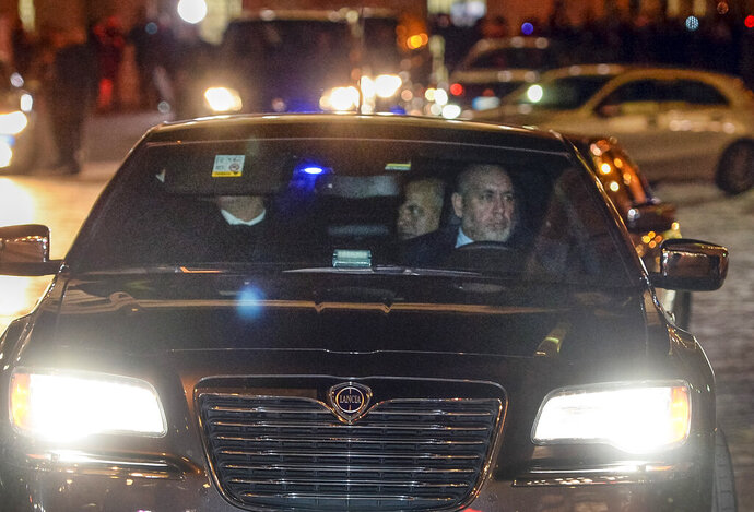 A car carrying Libyan eastern-based forces General Khalifa Hifter, center, leaves Italian Premier Giuseppe Conte's office in Rome, Wednesday, Jan. 8, 2020. Hifter traveled to Rome on Wednesday on a previously unannounced visit to meet with Italian Premier Giuseppe Conte. An Italian government spokesman, Rocco Casalino, said Serraj was expected to meet with Conte later in the evening. (Fabio Cimaglia/LaPresse via AP)