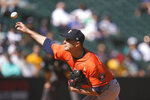 Houston Astros starting pitcher Jake Odorizzi throws against the Seattle Mariners in the fourth inning of a baseball game Wednesday, Sept. 1, 2021, in Seattle. (AP Photo/Elaine Thompson)