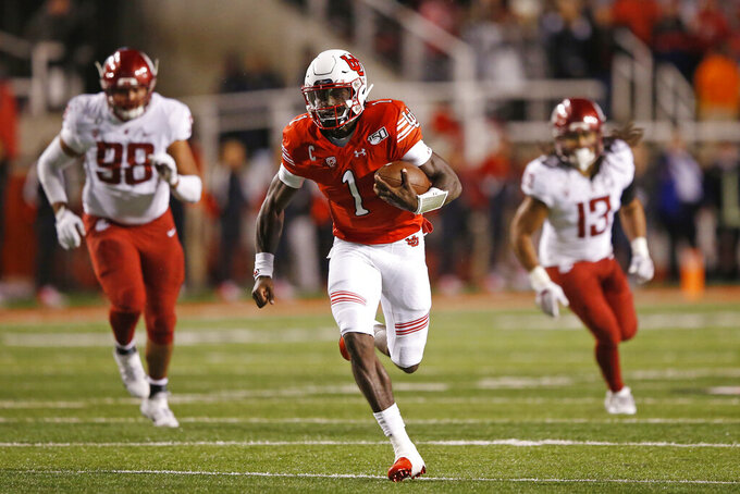 Utah quarterback Tyler Huntley (1) carries the ball against Washington State in the first half of an NCAA college football game Saturday, Sept. 28, 2019, in Salt Lake City. (AP Photo/Rick Bowmer)