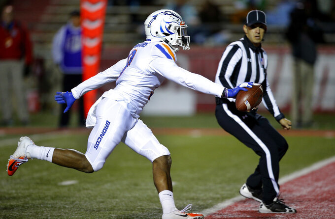 Boise State linebacker Desmond Williams scores a touchdown after forcing a fumble by New Mexico running back Zahneer Shuler during the first half of an NCAA college football game in Albuquerque, N.M., Friday, Nov. 16, 2018. (AP Photo/Andres Leighton)