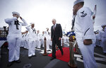 Navy Secretary Richard Spencer embarks the USS John S. McCain for a rededication ceremony at the U.S. Naval base in Yokosuka, southwest of Tokyo, Thursday, July 12, 2018. Spencer dedicated one of two destroyers involved in fatal accidents in the Pacific last year to Sen. John McCain. He added McCain's name to a Japan-based warship that was already named for the Arizona senator's father and grandfather. (AP Photo/Eugene Hoshiko)