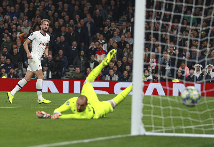 Tottenham's Harry Kane scores his side's fifth goal during the Champions League, group B, soccer match between Tottenham and Red Star Belgrade, at the Tottenham Hotspur stadium in London, Tuesday, Oct. 22, 2019. (AP Photo/Ian Walton)