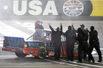 Austin Hill, left, cheers with his crew after winning the NASCAR Westgate 200 auto race at Las Vegas Motor Speedway, Friday, Sept. 25, 2020, in Las Vegas. (Ellen Schmidt/Las Vegas Review-Journal via AP)