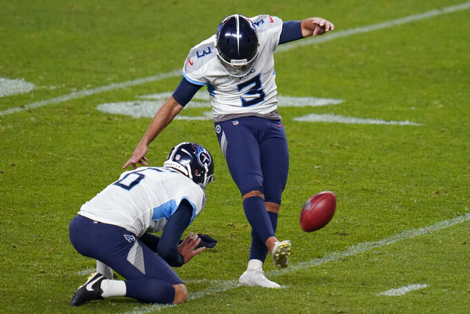 Tennessee Titans kicker Stephen Gostkowski (3) kicks the game winning field goal as punter Brett Kern (6) holds during the second half of an NFL football game against the Denver Broncos, Monday, Sept. 14, 2020, in Denver. (AP Photo/Jack Dempsey)