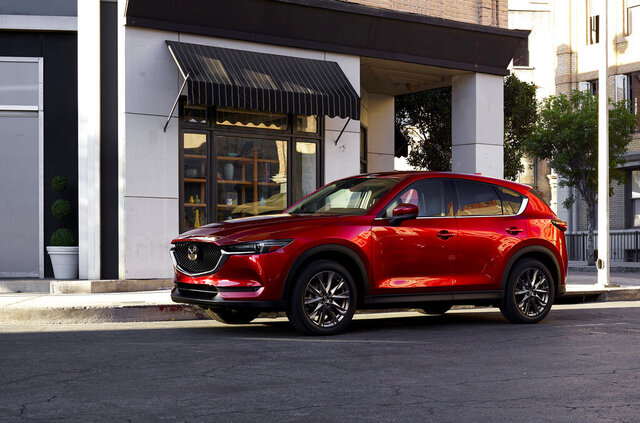 This photo provided by Mazda shows the 2021 Mazda CX-5, one of Edmunds' top-rated compact crossovers. The CX-5 is notable for its sharp styling, excellent handling and luxurious interior materials. (Courtesy of Mazda North American Operations via AP)