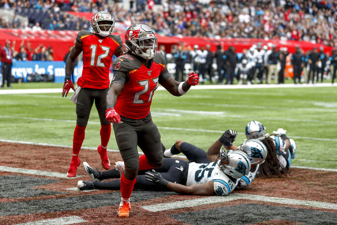 Tampa Bay Buccaneers running back Ronald Jones (27) reacts after scoring a touchdown against the Carolina Panthers during the second quarter of an NFL football game, Sunday, Oct. 13, 2019, at Tottenham Hotspur Stadium in London. (AP Photo/Alastair Grant)