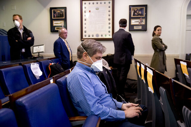 Members of the media wait in line to receive a test for COVID-19 by the White House Medical Unit before attending a news conference with President Donald Trump in the press briefing room at the White House, Thursday, April 9, 2020, in Washington. (AP Photo/Andrew Harnik)
