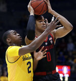 Stanford's KZ Okpala, right, looks to pass away from California's Juhwan Harris-Dyson (2) in the first half of an NCAA college basketball game Sunday, Feb. 3, 2019, in Berkeley, Calif. (AP Photo/Ben Margot)