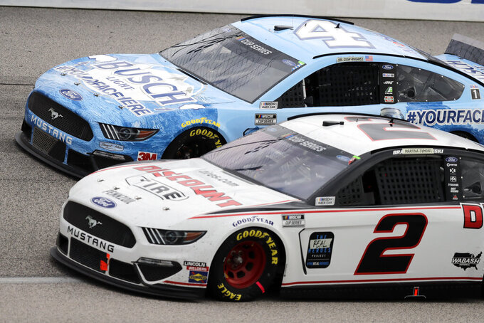 Kevin Harvick (4) and Brad Keselowski (2) compete during the NASCAR Cup Series auto race Sunday, May 17, 2020, in Darlington, S.C. (AP Photo/Brynn Anderson)