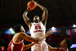 FILE - Western Kentucky center Charles Bassey (23) shoots against Arkansas during an NCAA college basketball game in Bowling Green, Ky., in this Saturday, Dec. 7, 2019, file photo. This 6-11 junior was the nation's No. 6 overall prospect in his class according to composite rankings of recruiting sites compiled by 247Sports, but he signed with Western Kentucky instead of choosing a major-conference power.(Austin Anthony/Daily News via AP, File)