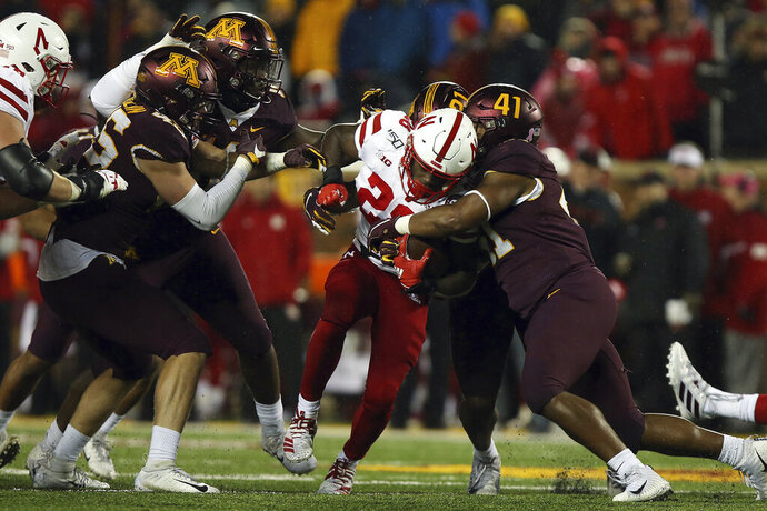 Nebraska running back Maurice Washington tries to break through the tackle of Minnesota linebacker Thomas Barber during the second half of an NCAA college football game Saturday, Oct. 12, 2019, in Minneapolis. (AP Photo/Stacy Bengs)