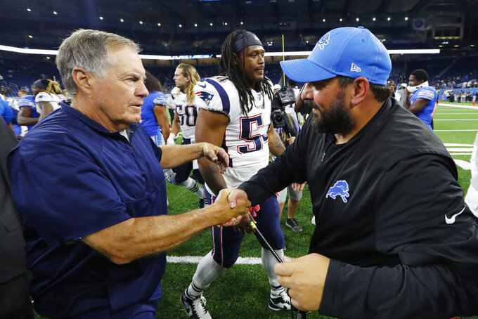 New England Patriots coach Bill Belichick, left, greets Detroit Lions coach Matt Patricia after a preseason NFL football game Thursday, Aug. 8, 2019, in Detroit. (AP Photo/Paul Sancya)