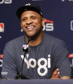 FILE - In this Oct. 8, 2018, file photo, New York Yankees starting pitcher CC Sabathia responds to a question during a news conference before Game 3 of baseball's American League Division Series, in New York. The New York Yankees gave pitcher CC Sabathia a $500,000 performance bonus, even though the 38-year-old left-hander was ejected from his final regular-season start six outs shy of the 155 innings specified for the payment in his contract. (AP Photo/Frank Franklin II, File)