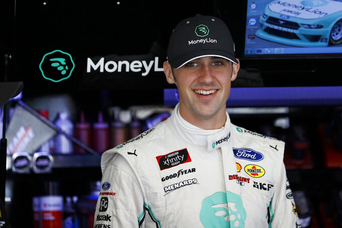 Austin Cindric smiles in his garage stall before a practice session for Saturday's NASCAR Xfinity Series auto race at Pocono Raceway, Friday, May 31, 2019, in Long Pond, Pa. (AP Photo/Matt Slocum)