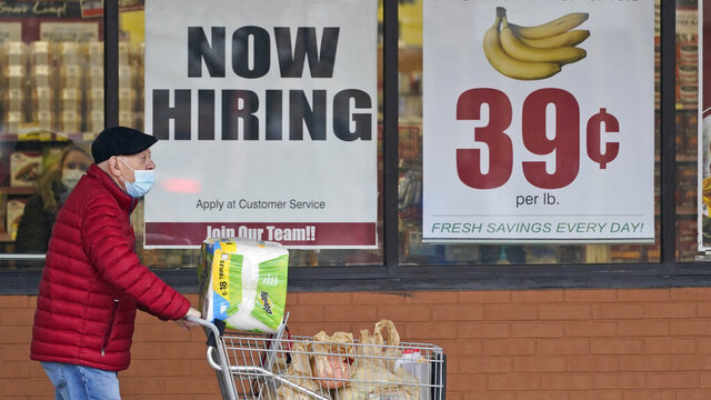 FILE - A man walks out of a Marc's Store,  Friday, Jan. 8, 2021, in Mayfield Heights, Ohio.  Fewer Americans applied for unemployment benefits last week, lowering claims to 900,000, still a historically high level that points to further job cuts in a raging pandemic. (AP Photo/Tony Dejak, file)