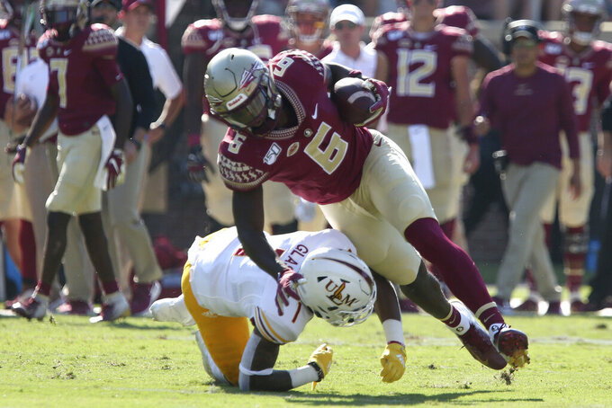 Florida State's Tre' McKitty (6) is tackled by Louisiana-Monroe's Tyler Glass after making a reception in the first quarter of an NCAA college football game Saturday, Sept. 7, 2019, in Tallahassee Fla. (AP Photo/Steve Cannon)