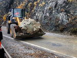 This photo provided by the California Department of Transportation (Caltrans) shows crews cleaning up a rock slide caused by storms, Saturday, Dec. 7, 2019, in Big Sur, Calif. A winter storm brought strong wind along with heavy rain and snow across Northern California on Saturday. (Caltrans via AP)